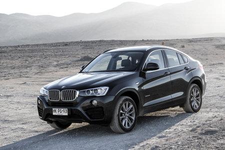 black: ANTOFAGASTA, CHILE - NOVEMBER 14, 2015: New black crossover BMW F26 X4 at the Atacama desert.