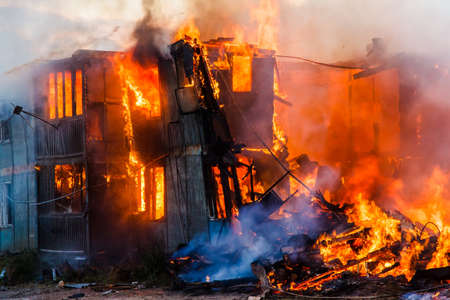 anomalous: Burning old wooden house
