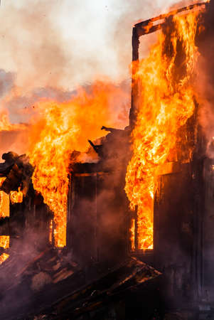 burning house: Burning old wooden house