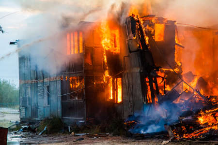 anomalies: Burning old wooden house