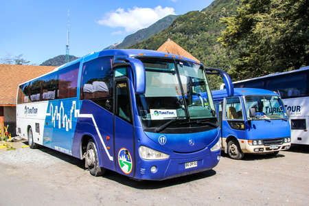 intercity: LOS LAGOS, CHILE - NOVEMBER 21, 2015: Intercity coach Irizar Century in the tourist center near the volcano Osorno. Editorial