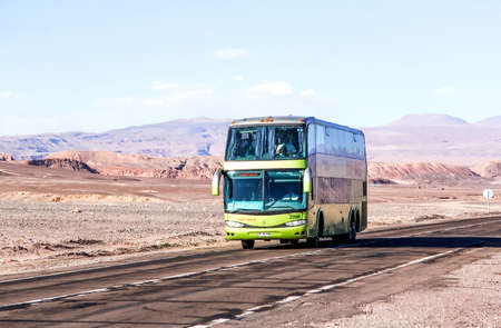 intercity: ANTOFAGASTA, CHILE - NOVEMBER 15, 2015: Interurban double-decker coach Marcopolo Paradiso 1800DD at the intercity freeway through the Atacama desert.