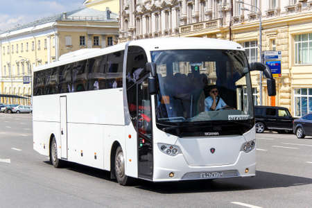 intercity: MOSCOW, RUSSIA - JUNE 2, 2013: White intercity coach bus Lahti Scania OmniExpress 360 at the city street. Editorial