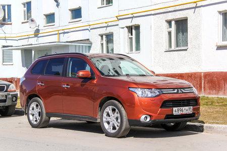 mmc: NOVYY URENGOY, RUSSIA - JUNE 13, 2014: Motor car Mitsubishi Outlander in the city street.