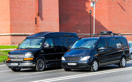 outside machines: MOSCOW, RUSSIA - MAY 5, 2012: Modern vans Chevrolet Express and Mercedes-Benz W639 Viano  in the city street.