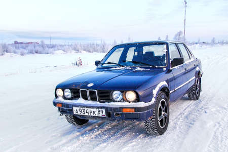 bmw: NOVYY URENGOY, RUSSIA - MARCH 24, 2013: Motor car BMW E30 324d in the city street.