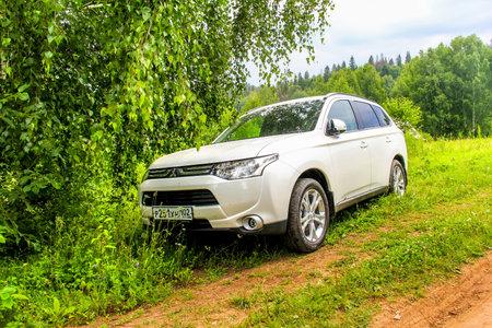 outlander: PAVLOVKA, RUSSIA - JULY 5, 2014: Motor car Mitsubishi Outlander at the countryside.
