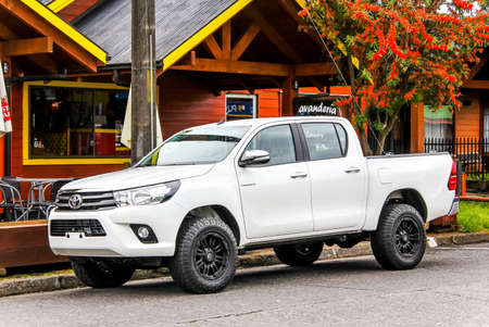 PUCON, CHILE - NOVEMBER 20, 2015: Brand new pickup truck Toyota Hilux at the town street.