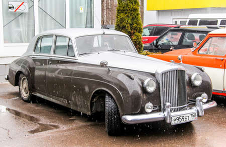 outside machines: MOSCOW, RUSSIA - MARCH 8, 2015: Motor car Bentley S in the city street.