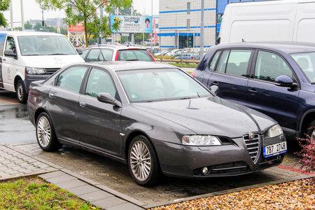 alfa: BRNO, CZECH REPUBLIC - JULY 22, 2014: Motor car Alfa Romeo 166 at the city street. Editorial