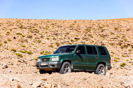 trooper: ANTOFAGASTA, CHILE - NOVEMBER 16, 2015: Green off-road car Chevrolet Trooper at the country road.