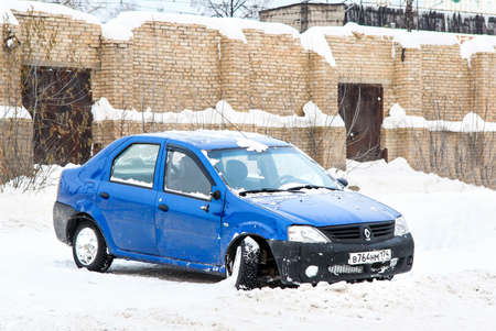 crashed: ASHA, RUSSIA - NOVEMBER 19, 2011: Crashed motor car Renault Logan in the city street.