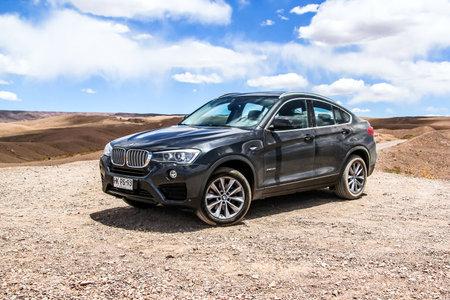 crossover: ANTOFAGASTA, CHILE - NOVEMBER 15, 2015: New black crossover BMW F26 X4 at the Atacama desert.