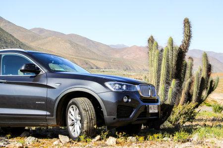 crossover: ATACAMA, CHILE - NOVEMBER 13, 2015: New black crossover BMW F26 X4 at the Atacama desert.