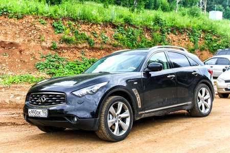 fx: PAVLOVKA, RUSSIA - JULY 5, 2014: Motor car Infiniti FX at the countryside.