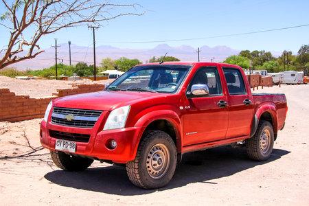 utilitarian: SAN PEDRO DE ATACAMA, CHILE - NOVEMBER 17, 2015: Red pickup truck Chevrolet LUV D-Max at the countryside.