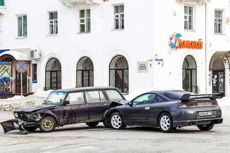 contorted: ASHA, RUSSIA - JANUARY 19, 2012: Crashed motor cars Lada Zhiguli and Mitsubishi Eclipse in the city street. Editorial