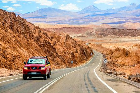 nissan: ANTOFAGASTA, CHILE - NOVEMBER 15, 2015: Red pickup truck Nissan Navara at the interurban road. Editorial