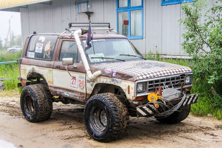 bronco: NOVYY URENGOY, RUSSIA - JULY 17, 2013: Off-road motor car Ford Bronco II in the city street.