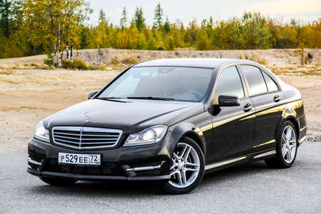 NOVYY URENGOY, RUSSIA - AUGUST 30, 2015: Motor car Mercedes-Benz W204 C-class at the countryside. 에디토리얼