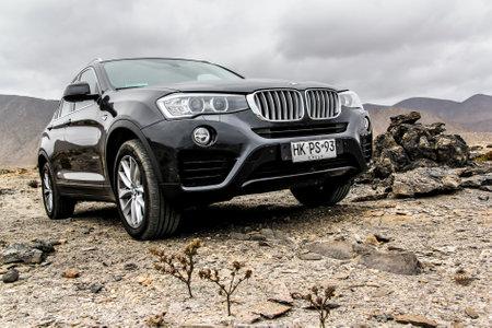 crossover: ATACAMA, CHILE - NOVEMBER 14, 2015: New black crossover BMW F26 X4 at the stone desert.