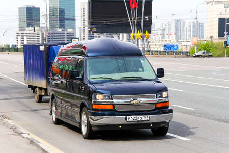 capacious: MOSCOW, RUSSIA - MAY 6, 2012: Luxury van Chevrolet Express in the city street.