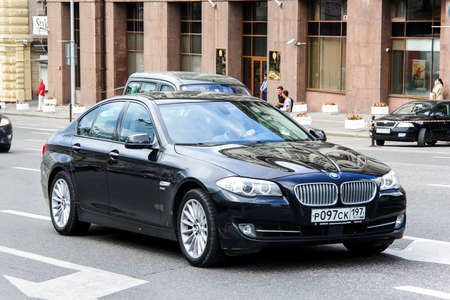 outside machines: MOSCOW, RUSSIA - JUNE 2, 2013: Motor car BMW F10 5-series at the city street. Editorial