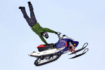 supercross: NOVYY URENGOY, RUSSIA - APRIL 6: Anders Ericsson performes a trick at the annual Russian Snocross Championship on April 6, 2013 in Novyy Urengoy, Russia. Editorial
