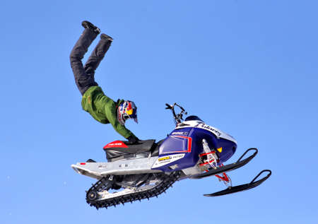 ericsson: NOVYY URENGOY, RUSSIA - APRIL 6: Anders Ericsson performes a trick at the annual Russian Snocross Championship on April 6, 2013 in Novyy Urengoy, Russia. Editorial