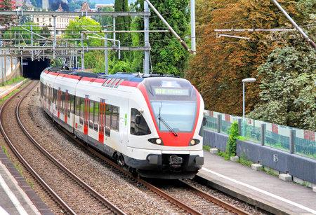 intercity: MONTREUX, SWITZERLAND - AUGUST 6, 2014: White and red swiss short distance passenger train SBB-CFF-FFS RABDe 500 at the railway.