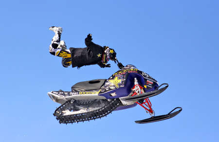 supercross: NOVYY URENGOY, RUSSIA - APRIL 6: Markus Nordin performes a trick at the annual Russian Snocross Championship on April 6, 2013 in Novyy Urengoy, Russia.