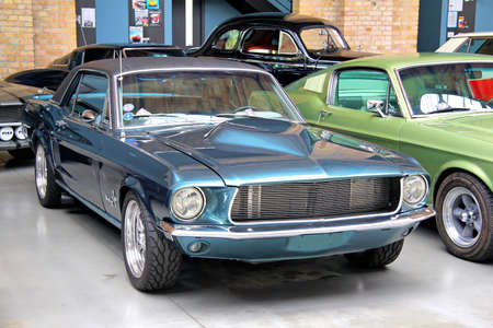 mustang gt: BERLIN, GERMANY - AUGUST 12, 2014: Classic american muscle car Ford Mustang in the museum of vintage cars Classic Remise.