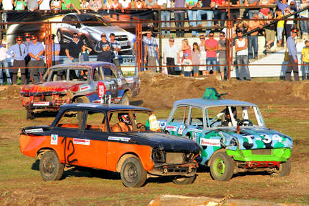 UFA, RUSSIA - AUGUST 1: Unidentified competitors Moskvitch-412 No. 12 and No. 102 take part at the Arena 89 Demolition Derby on August 1, 2012 in Ufa, Russia.