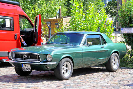 supercharged: BERLIN, GERMANY - AUGUST 12, 2014: Classic american muscle car Ford Mustang near the museum of vintage cars Classic Remise.