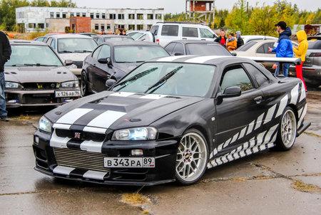 nissan: NADYM, RUSSIA - AUGUST 29, 2015: Drift car Nissan Skyline GT-R at the city street. Editorial
