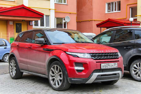 outside machines: NOVYY URENGOY, RUSSIA - SEPTEMBER 9, 2012: Motor car Range Rover Evoque in the city street.
