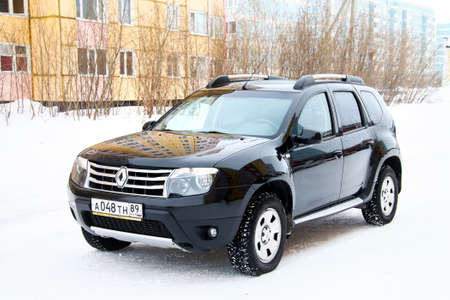 outside machines: NOVYY URENGOY, RUSSIA - MARCH 20, 2016: Motor car Renault Duster in the city street.