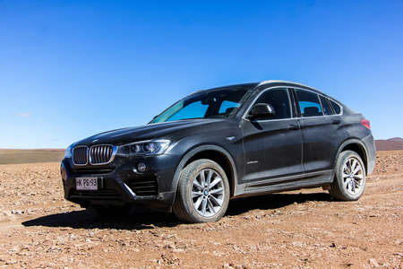 crossover: ANTOFAGASTA, CHILE - NOVEMBER 16, 2015: New black crossover BMW F26 X4 in the Atacama desert.