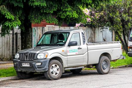 utilitarian: VILLARRICA, CHILE - NOVEMBER 20, 2015: Grey pickup truck Mahindra Scorpio in the city street. Editorial