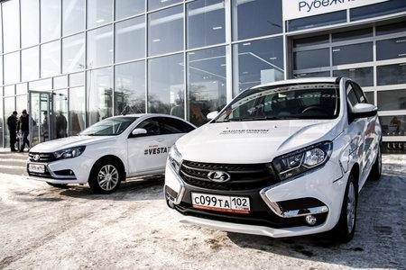 new motor cars: UFA, RUSSIA - FEBRUARY 14, 2016: Brand new motor cars Lada X-Ray and Lada Vesta in the Lada trade center.