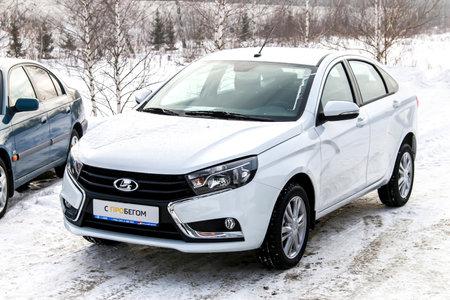 new motor car: UFA, RUSSIA - FEBRUARY 14, 2016: Brand new motor car Lada Vesta in the Lada trade center.