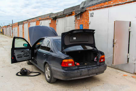 class maintenance: NOVYY URENGOY, RUSSIA - JUNE 26, 2015: Motor car BMW E39 520i is washed and cleaned near the garage.