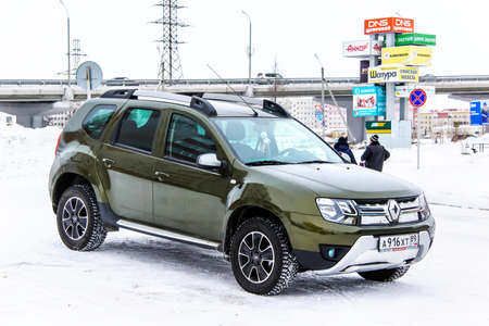 utilitarian: NOVYY URENGOY, RUSSIA - FEBRUARY 4, 2016: Motor car Renault Duster in the city street. Editorial