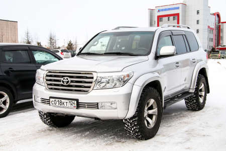 customized: NOVYY URENGOY, RUSSIA - MARCH 9, 2016: Motor car Toyota Land Cruiser 200 customized by the Arctic Trucks company in the city street.