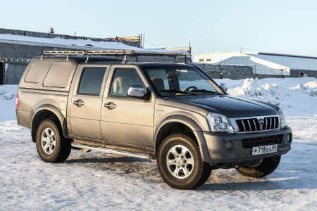 utilitarian: NOVYY URENGOY, RUSSIA - MARCH 24, 2016: Pickup truck Great Wall Socool in the city street.