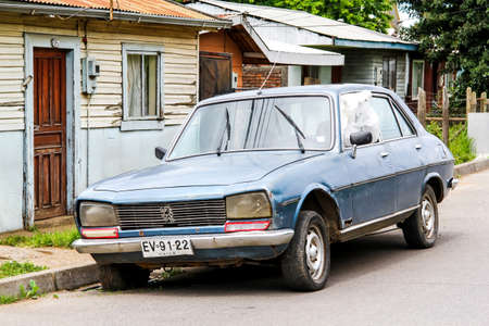 outside machines: TEMUCO, CHILE - NOVEMBER 22, 2015: Motor car Peugeot 504 in the town street.