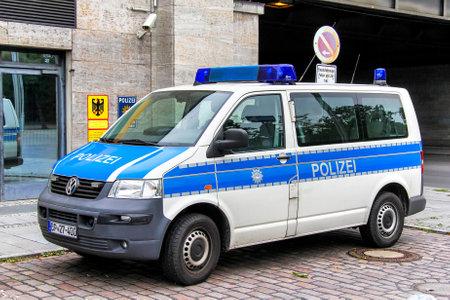 BERLIN, GERMANY - SEPTEMBER 10, 2013: Police van Volkswagen Transporter in the city street.
