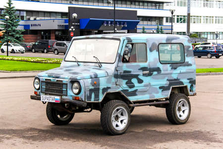 utilitarian: MOSCOW, RUSSIA - JUNE 2, 2013: Soviet off-road car LuAZ 1302 Volyn in the city street.