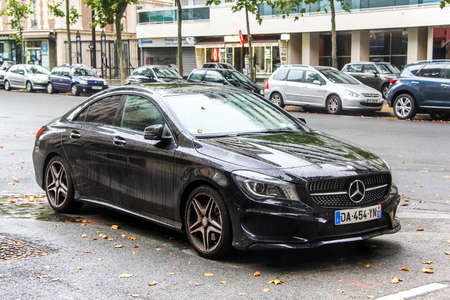 motor car: PARIS, FRANCE - AUGUST 8, 2014: Motor car Mercedes-Benz C117 CLA-class in the city street. Editorial