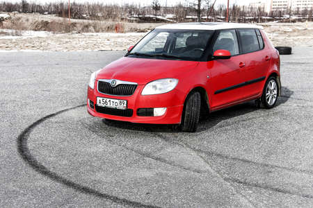hatchback: NOVYY URENGOY, RUSSIA - MAY 13, 2016: Bright red compact hatchback car Skoda Fabia in the city street.